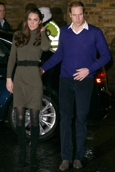 December 21, 2011 — For a visit to a homeless charity just before Christmas, Kate wore a green sweater dress with a black belt and knee-high boots.