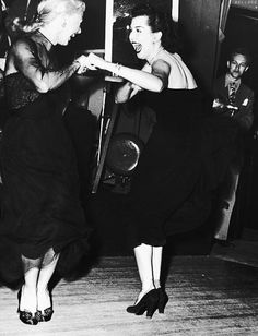 Ginger Rogers and Ann Miller dancing the Charleston together at the Mocambo nightclub in West Hollywood, February 1950.