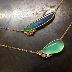 Australian Opal and Andean Opal pendants with incorporate chain, made in 18k gold, accented with color sapphires and diamonds.
