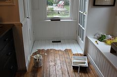 How to paint wood floors that are too damaged to be refinished
