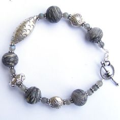 Etched lampwork bead and bali silver bracelet