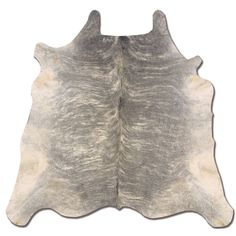 Provide a unique, Western-themed foundation to your decor with this authentic full cowhide rug, featuring a light tawny finish. The natural shape and color variations of this genuine animal skin lend an organic feel to your home.