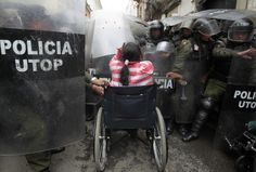 Disabled Protesters Vs. Riot Police  These photos are unreal. A protest in Bolivia demanding rights for the disabled turned violent yesterday as hundreds of people in wheelchairs and crutches clashed with riot police.