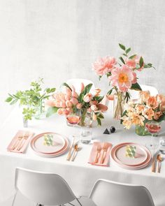 """Let single-bloom arrangements and pastel plates soften an otherwise all-white tablescape.From left: Green hellebores match up with Solomon's seal leaves, and hosta leaves complement French tulips. Peonies and Solomon's seal mingle in a tall vase, and finally, pale parrot tulips go solo to stunning effect. To useour editable place cards, download themhere.Iittala """"Aalto"""" vases, from $125;finnstyle.com. Kate Spade Saturday plates, from $10 each, and salt and peppe..."""
