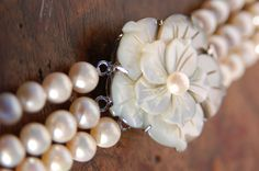 Flower Clasp Tripple Strand Fresh Water Pearl Necklace.  By Purple Lotus Jewelry & Co.