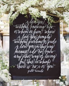 "11 Unique Ways to Show Off Your Favorite Quotes at Your Wedding | Martha Stewart Weddings - A verse from Pablo Neruda's ""100 Love Sonnets,"" printed on an oversize canvas, hung above the gift table at this wedding in Georgia."