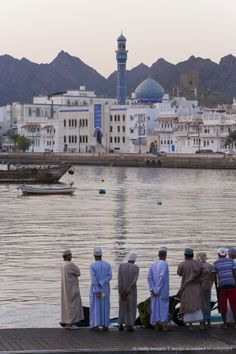 Oman, Muscat, Fish market and city skyline