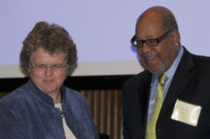 Assistant Secretary Kathy Greenlee and SeniorNet Board of Directors Chairman Leslie M. Smith