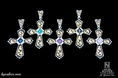 What's your favorite color? This large cross pendant features an authentic gemstone, surrounded by crystal clear stones.  Black antique accents surround intricate yellow gold overlay scroll work and silver beads decorate the border. With 5 gemstones to choose from, you're sure to find one for your collection.