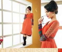 Wonderful And Attractive Orange #Tunic With Floral Embroidery And Classy Look #kurtis #craftshopsindia