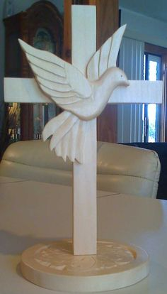 """Cross with dove in middle - from a pattern by Dennis Moor in """"The Best of Woodcarving Illustrated, Chip Carving. Wooden Crosses, Wall Crosses, Wooden Art, Wood Carving Patterns, Carving Designs, Wood Projects, Woodworking Projects, Projects To Try, Wood Crafts"""
