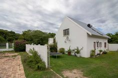 Situated in a quiet suburb, adjacent to the natural dune forests of Port Alfred, this cluster home offers peace and tranquility. Comprised of open plan. Open Plan Living, Lofts, Dune, Living Area, Shed, Outdoor Structures, Loft Room, Loft, Attic