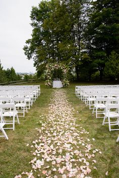 rose petal aisle, pink + white floral alter  white chairs for outdoor summer wedding ceremony