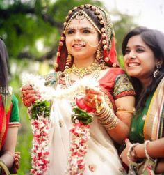Traditional Indian bride wearing bridal jewellery and lehenga #Pinned by Sumit Kochar #http://www.pinterest.com/sumitkochar/