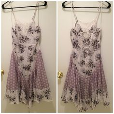Free people slip dress corset tie back size Small Super cute flowers printed on the dress. The floral print is like a lilac purple, smoky purpley gray, and white. New with tags. Could be layered over or under another dress for a classic Free People boho chic look. Check out my closet for more Free People items! I give bundle discounts! Free People Dresses