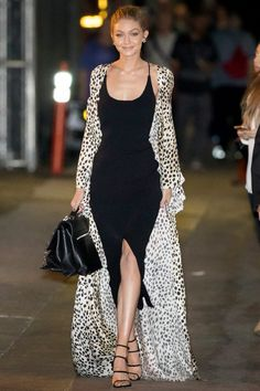 Gigi Hadid in a black midi dress and floor-length leopard-print coat