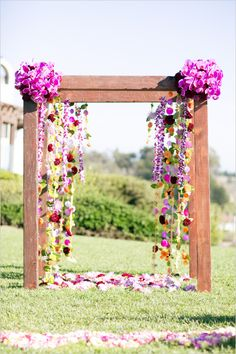 Gorgeous bright floral outdoor ceremony décor! #Flower #Orchid #Bloom #Ceremony #Outdoor #Colors #Colours #Wedding #Arch #Halter #Bright #Event #Décor #Purple #Pink #Green #Yellow