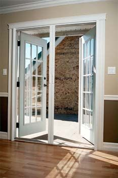 Double larson storm doors give the look of french doors - Exterior french doors that open out ...