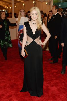 Dakota Fanning attends the Costume Institute Gala for the PUNK: Chaos to Couture exhibition at the Metropolitan Museum of Art on May 2013 in New York City. Gala Dresses, Dresses 2013, Nice Dresses, Evening Dresses, Met Gala Red Carpet, Red Carpet Gowns, Dakota Fanning, Katy Perry, Celebrity Costumes
