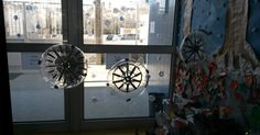 Recycling and doing handmade and beautiful snowflakes made with plastic bottles.