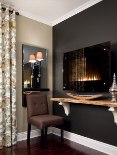 Fireplace Design • Ethanol Fireplace • Designing with Dark Walls • Mirror Sconce  #candiceolson #candiceolsondesign Ethanol Fireplace, Fireplace Wall, Fireplace Design, Fireplace Ideas, Fireplaces, Candice Olson, Dark Walls, Interior Decorating, Interior Design