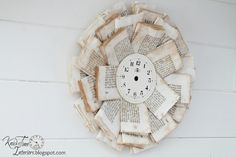Book Page Wreath - cumpled and folded book pages glued to an old CD base and a clock face center front.