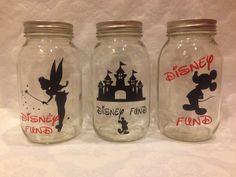 I want the Tinker Bell jar! Disney Money, Disney Diy, Disney Crafts, Disney Cruise, Disney Stuff, Walt Disney, Mason Jar Bank, Mason Jar Wine Glass, Mason Jar Projects