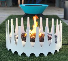 """From minimalist concrete designs to portable """"tables,"""" these features make a fun (and functional) focal point for your outdoor space."""