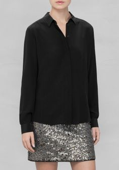 Made from luscious silk, this wardrobe essential has a classic fit with a buttoned front and pointy collar.