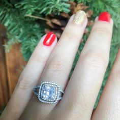 "Say ""I DO"" this holiday season with this Cathedral setting split shank double cushion halo engagement ring featuring pavé-set round diamonds set halfway down the shank by Demarco!"