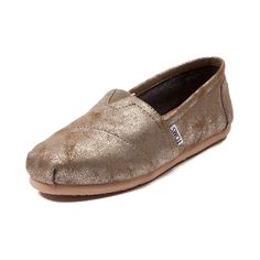 Shop for Womens TOMS Classic Slip On Casual Shoe in Gold at Journeys Shoes. Shop today for the hottest brands in mens shoes and womens shoes at Journeys.com.The new Classic Slip-On Casual Shoe from TOMS is as good as gold! The Classic Slip-On blends subtle shine and casual comfort that you can wear all day and into the night. Only available online at Journeys.com and SHIbyJourneys.com!Features include TOMS toe-stitch, and elastic V for easy on and off TOMS classic suede insole with cushion…