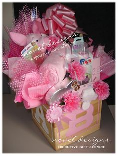 Pretty Pink Piglet Gift Basket - All things pretty, pink and piglet for the new baby girl. noveldesignsllc.com