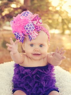Dark Purple and Hot Pink Over The Top Bow by loveablebabyboutique, via Etsy.