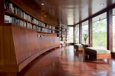 I love the bookcases built in here with the wall of windows.