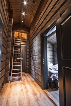 // Cocooning chalet // martine Haddouche I like the trim around the door with this paneling