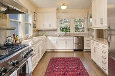 This extraordinary Queen Anne home boasts beautiful views and in-city privacy.