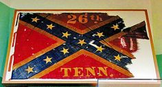 The War Torn Cross, the fourth battle flag of the 26th Tennessee Infantry. August Depot issue, 1864