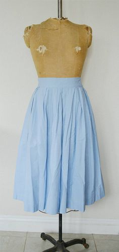 Vintage 1950s Powder Blue skirt. Hook and eye at the side with clasps for extra secure. Signs of general minor wear at waist near clasps, does not take away from the beauty of this cotton skirt. Pleated a little at the waist.  |d e t a i l s|  No Tag • Great vintage condition • Dry Cleaned and Ready to wear  |m e a s u r e m e n t s| (Measured in inches and doubled for exact sizing)  Waist: 33 Hips: Open Length: 30.5  *please inquire for international shipping, tracking or any other details*