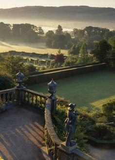 View from the Top Terrace in the garden at Powis Castle, Powys, Wales taken at dawn. The view shows the 17th century Italianate terraces below, as well as the architectural features and statues. The garden at Powis has survived the 18th century reaction against the formality of earlier garden design, and Powis is thus one of the few places in Britain where a true baroque garden may still be fully appreciated.