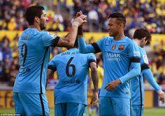 Barcelona forward Luis Suarez (left) celebrates scoring his side's opening goal against Las Palmas with team-mate Neymar on Saturday