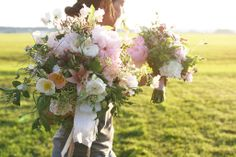 lush organic pink and white wedding bouquet with poppies, peonies and lilies | floral design: Floret Flowers