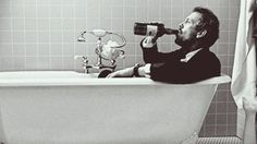 just sitting in the tub, drinking as usual.