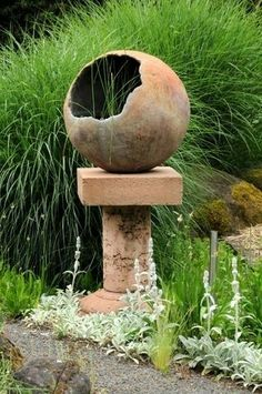 Hollow cement sphere on pedestal