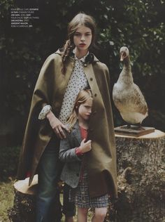 Olympia Le-Tan gabardine cape with embroidered edelweiss buttons in French Elle.