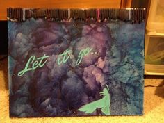 """I love Frozen and I love melted crayon art so I combined the two into this piece. Just cut out and glue Elsa's silhouette and the words """"Let it go"""" and you've got yourself an awesome decoration"""