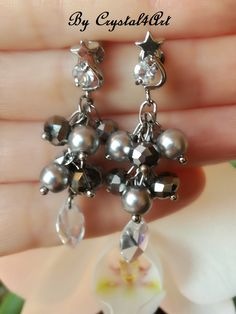 """Shining stars"" handcrafted earrings are created by using glass pearls and multifaceted glass crystals. See more by visiting my online shop https://www.breslo.ro/crystal4art"