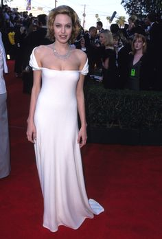 With a dark, golden blonde 'do, she donned this open-shoulder white gown at the SAG Awards.   - MarieClaire.com