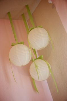 Paper lanterns as decorations...Love the ribbon addition!