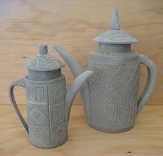 Slab teapots...Ginger Steele. I miss throwing clay on the wheel, rolling slabs, glazing... and these get me in the mood.