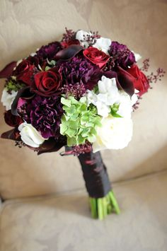 White & Purple Bouquet with dark purple black callas, black baccara roses, green hydrangea, red seeded euc, white stock, white phlox, and dark purple callas